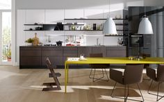Modern kitchen with handles_ Bright yellow table to add a pop of colour