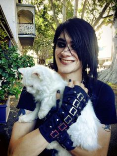 Goth guy holding a cat. <3