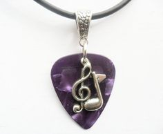 Purple Guitar pick necklace with treble clef music note charm that is adjustable…