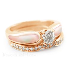 "This alternative pink engagement ring features pink mother of pearl, diamonds, and 14k rose gold. This ""Lustrous Rose"" ring is pictured with one diamond wedding band - though it can also be worn with another along the top!"