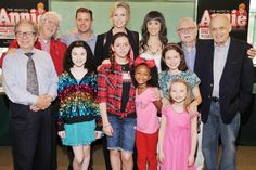 The cast and creators of ANNIE are all smiles at the CD signing.