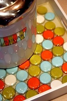 spray paint bottle caps, use resin to create a tray top/or table top (depending on how many bottle caps you have)