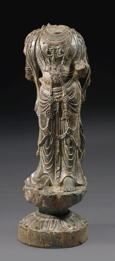 A RARE GRAY STONE TORSO OF A BODHISATTVA  - TANG DYNASTY.