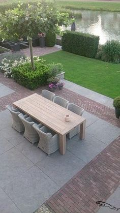 Beautiful dinner in a beautifully landscaped garden. The garden adjoins the water for a nice effect. See more garden furniture on www.nl, Photo posted by Kees Smit Tuinmeubelen am Wie. Back Gardens, Small Gardens, Outdoor Gardens, Patio Edging, Patio Tiles, Outside Patio, Interior Exterior, Dream Garden, Backyard Landscaping