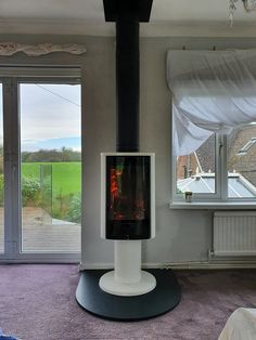 Contura woodburner, installed near Romsey, Hampshire by Moxom Fires, with granite hearth and MF twinwall flue. Granite Hearth, Freestanding Fireplace, New Forest, Stoves, Wood Burning, Hampshire, This Is Us, Home Decor, Ovens