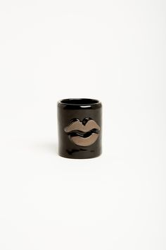 LUX / EROS Kiss Collection-  The Kiss Collection pays homage to the motif on vases and tumblers adorned with a variety of lips, some are sealed others open to a butterfly smack. Each Kiss espresso cup is handmade and original and comes with a kiss! - black glaze on black clay with lips detail