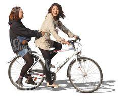 Two smiling Asian girls riding a bike.