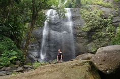 Getting up close to a waterfall in St Lucia. Our guide cracked open a fresh coconut for afternoon snacks. Yum!