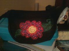 painted with fabric paint to cover a logo on a fanny pack