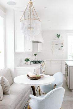 Stephanie Gamble Interiors - White Kitchen Design - La Cornue - Aerin Lauder Pendant - Banquette Seating