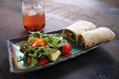 Lunch! Hummus red pepper avocado olive wrap with sun made blueberry iced tea.