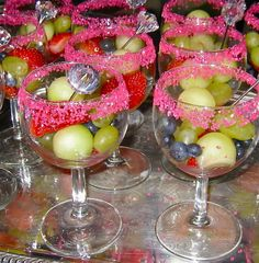 """Fruitinis    Rim goblet with Pink Crystals…yes, they make pink. Cut up your fruit, use a melon baller if you like. Add a fancy party pick. These """"diamond"""" picks were for a wedding shower purchased at hobby lobby (company was mud pie) in wedding section. Pick party pick to match your theme. """"Drink Umbrellas"""" are cute too. Pier one has the long wooden party picks with beautiful/fun designs."""