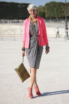 Stylist Elisa Nalin styled a graphic print dress with an eye-catching hot pink blazer.