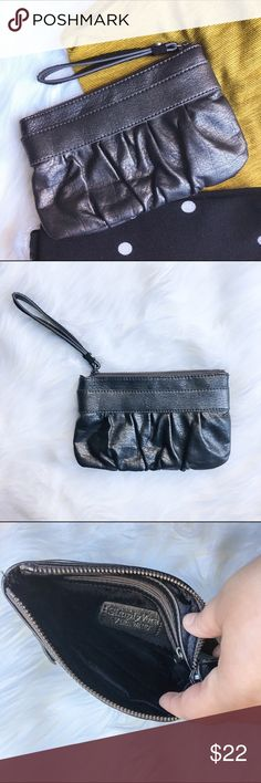 Simply Vera - Vera Wang Silver Wrislet This silver wristlet with a subtle shimmer will be perfect for the upcoming holidays, or any time you want to add a little glam to your outfit! This is in perfect condition and is no longer available in stores. Simply Vera Vera Wang Bags Clutches & Wristlets