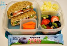 Here's what's inside: Strawberry & Kiwi Waffle Sandwich (toast 2 whole grain waffles, spread 2 T. of cream cheese onto the waffles, layer slices of strawberry & kiwi on top, make into a sandwich)= 30 carbs Stonyfield YoKids Yogurt Tube= 11 carbs Fresh fruit (strawberries, blueberries & kiwi)= 9 carbs Pirate's Booty Baked Rice & Corn Puffs= 5 carbs Carrots= 3 carbs Lunch Total= 58 carbohydrates