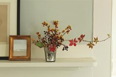 styling: autumn branches, gold frames, mix of artwork, wall color