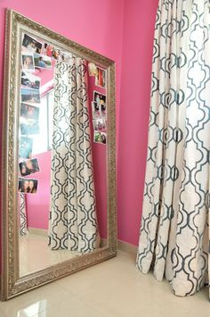 leaning mirror and hot pink walls