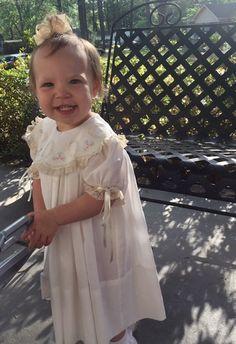 Ava Kate is adorable in her Mela Wilson Heirloom dress. Email mela.wilson2@comcast.net