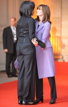Moochie is shown here with the First Lady of France and a wedgee!