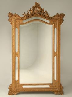 The mirror on Christine's wall.