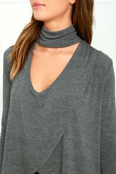 The Soho Chic Dark Grey Long Sleeve Top is your ticket to city chic style! Ultra-soft stretch knit starts at a slouchy turtleneck above a front cutout, then drapes into a relaxed, surplice bodice with a high low hem. Long fitted sleeves.