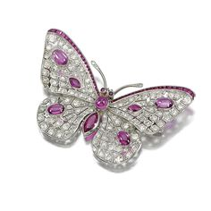 RUBY AND DIAMOND BROOCH, 1920S Designed as a butterfly, the body and wings pierced and millegrain-set with circular- and rose-cut diamonds, accented with variously cut and cabochon rubies, to circular-cut ruby eyes.