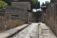 Herculanium - It's incredible how some of the streets could easily exist in present day, down to the sidewalks and gutters. Ancient Pompeii, Pompeii And Herculaneum, Minoan Art, Appian Way, Pompeii Italy, Roman City, Roman Architecture, Trevi Fountain, Roman History