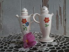 Check out this item in my Etsy shop https://www.etsy.com/listing/162582357/vintage-art-deco-salt-pepper-shakers