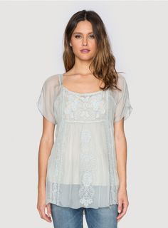 Rose Embroidered Tunic The 4 Love and Liberty ROSE EMBROIDERED TUNIC offers a ladylike take on the boho peasant blouse silhouette thanks to a luxe silk chiffon fabrication adorned by delicate tonal embroidery. This silk tunic top features a square neckline, short sleeves, and empire waist, ensuring a flowy and figure-flattering fit! Layer the ROSE EMBROIDERED TUNIC over a silk camisole and linen pants for an effortlessly chic look!  - Silk Chiffon - Semi-Sheer Material - Square Neckline, ...