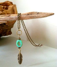 Hey, I found this really awesome Etsy listing at https://www.etsy.com/listing/130791421/boho-feather-necklace-antique-brass