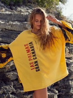 Sunkissed Pullover | The essential pullover for the season featuring a front destination-inspired graphic with mixed floral contrast details at the back and sleeves.      * Subtle side vents  * Oversized shape with flowy details  * Puffed sleeves