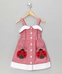 The larger-than-life ladybugs and picnic-inspired air of this dress are darling touches that make it picture-perfect. Big, easy buttons up the front will have pretties ready in a flash. Pair with white mary janes for a look that's as sweet as giggles.