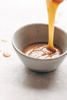 5 Minute Magic Vegan Caramel Sauce Magic Vegan Caramel Sauce made with coconut oil, real maple syrup, and almond butter. Microwave for one minute. Healthy Dessert Recipes, Healthy Sweets, Vegan Desserts, Vegan Caramel, Caramel Recipes, Slow Cooker Desserts, Vegan Sauces, Vegan Foods, Dairy Free Recipes