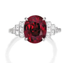 PLATINUM, RUBY AND DIAMOND 'PYRAMID' RING, TIFFANY & CO. Centered by a cushion-cut ruby weighing 5.45 carats, accented by graduated rows of square emerald-cut diamonds weighing .60 carat, size 7½, signed Tiffany & Co.