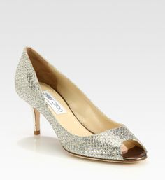 Ceremony Shoes!  Jimmy Choo Isabel Glitter Pump.  I have been debating on whether or not I want to add a shoe clip onto this to add even more sparkle.I normally wear a 9.5-10.  The sales person ordered a 41 for me which was too large.  I exchanged for a 40.