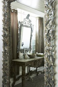 Antique pewter mirrors.