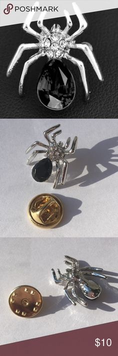 Silver Spider Brooch Pretty Silvertone spider brooch new in package. The back piece that the brooch hooks into is gold toned. Jewelry Brooches