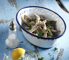 A simple small fried fish can be a delicacy!   Wash the anchovies in water. Strain and set aside. Combine all of the ingredients for the coating in a bowl. Dredge the fish...