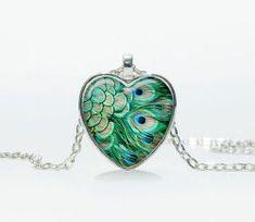 Peacock Heart Pendant $7.99 www.allthingspeacock.com - Peacock Necklaces