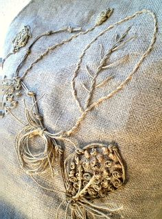 embroidery with twine . . . on burlap . . .