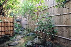 Japanese garden with traditional bamboo fences