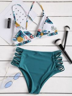 Opt for a feminine, retro look in this high waisted bikini bottom and triangle bikini top featuring a playful tropical print. The top is detailed with crossover strap back, while the strappy sides instantly lengthens the look of your legs. Team yours with cat-eye sunglasses for a style with waterside allure. #Zaful #Swimwear #Bikini