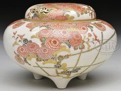 A Satsuma pottery incense burner, Meiji period, 1868-1912, Japan. Surface finely painted with iron-red, chrysanthemum flowers and enameled foliage