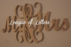 Connected Mr. and Mrs. wooden monogram sign. These are cut from 1/2 birch wood and 36 in length. These are unpainted.    Orders are processed as