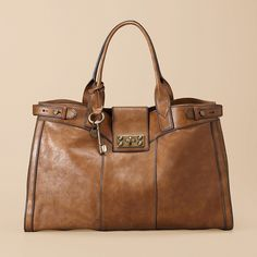 Fossil Weekender. This WILL be my next Fossil purchase. I'm obsessed with the Fossil vintage line.
