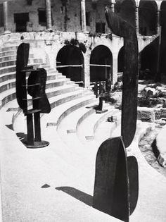"David Smith, ""Voltri"" sculptures in Roman amphitheater, Spoleto, Italy, 1962"