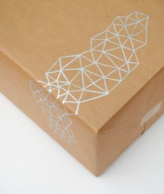 I love the triangle pattern on this hand-drawn giftwrap from minieco.co.uk   kraft paper brown paper silver sharpie