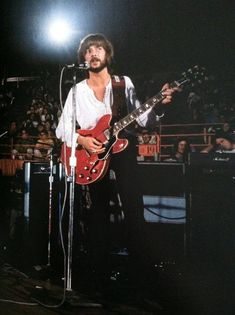 EC & Gibson cherry red ES-335 at the Forum in Los Angeles on 8/15/1969, with Blind Faith.