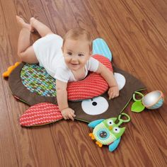 Skip Hop Treetop Friends: tummy time mat! Baby's daddy loves owls! I bet I could make this