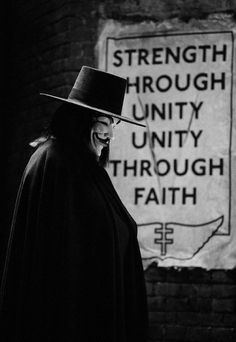 """V for Vendetta,"" 2006 Costume design: Sammy Sheldon black wool felt hat with grosgrain ribbon band and long black wool cape - worn by Hugo Weaving in the role of V V For Vendetta 2005, V Pour Vendetta, V For Vendetta Poster, V For Vendetta Quotes, Vendetta Mask, Film V, Film Serie, Pulp Fiction, Science Fiction"